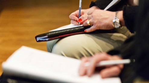 Writing at conference, close-up